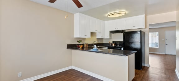 Kitchen and dining area at Terramonte Apartment Homes