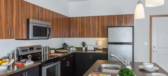 Fully Equipped Kitchen With Modern Appliances at Tivalli Apartments, Lynnwood, WA