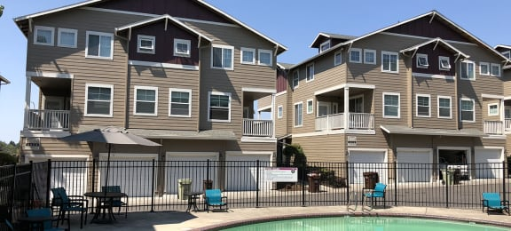 Chairs and Table on Sundeck near Pool at Westview Heights Apartments, 18301 NW Chemeketa Lane, OR