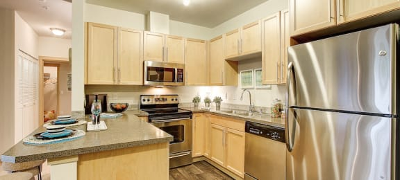 Refrigerator with Ice Maker, at Newberry Square Apartments, Lynnwood, Washington