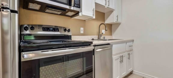Fremont Apartments- Lincoln Glen Apartments Kitchen With Stainless Steel Appliances and Sleek White Cabinetry