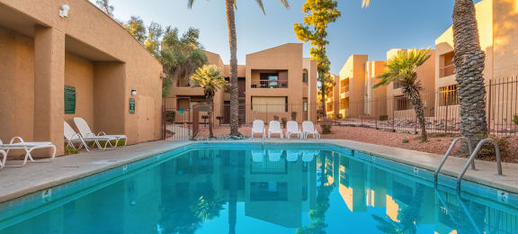 Sycamore creek pool view with nice relaxation areas and tall trees all around