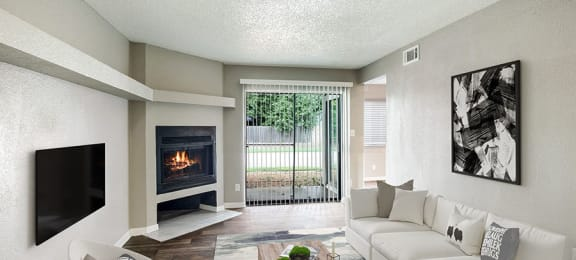 Model Living Area with Fireplace and Private Patio/Balcony