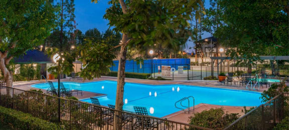 Evening pool view with lounge chairs Grand on Lindley 1 and 2 bedroom apts for rent in northridge ca