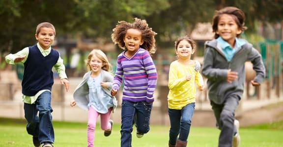 Kids running through grass