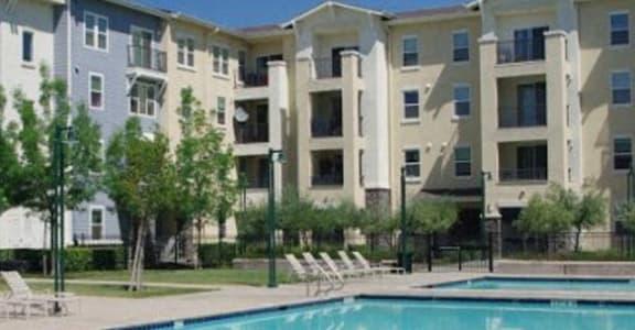 Pool with lounge chairs l Apartments in Dublin CA l Dublin Ranch Senior Apartments