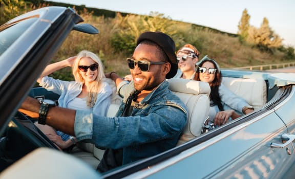 Friends driving in car