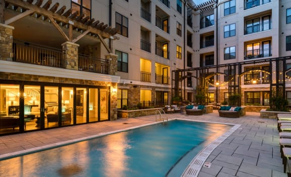 Swimming Pool with Lounge Seating with leasing office exterior at Berkshire Dilworth, Charlotte, North Carolina