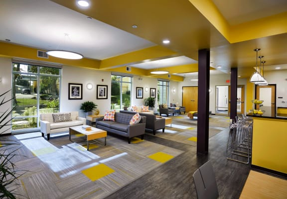 Community room with seating areas_Cornerstone Village Pittsburgh, PA