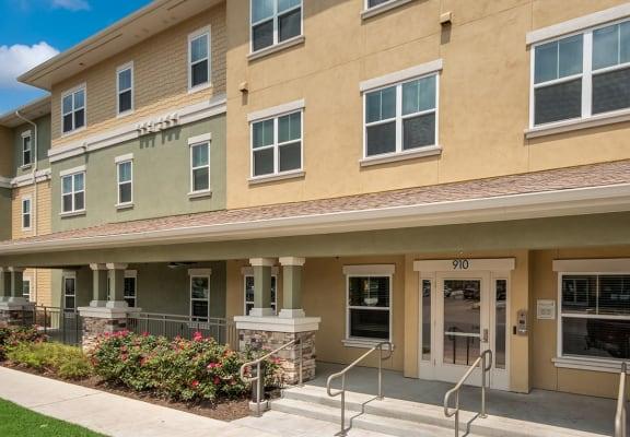 Apartment building and walkway-Wheatley Park Senior Apartments San Antonio, TX