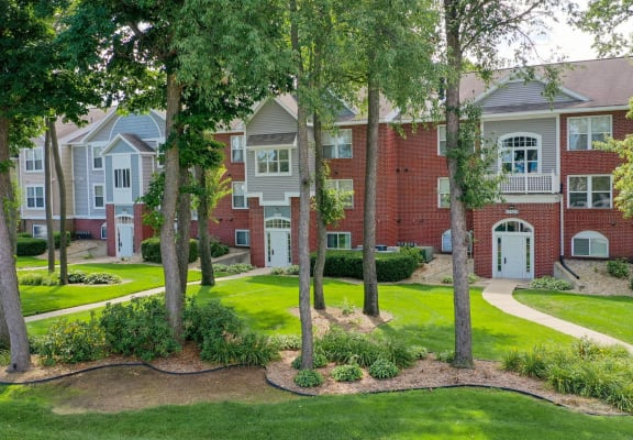 Green Spaces With Mature Trees at The Highlands Apartments, Elkhart