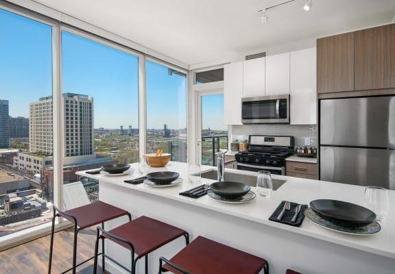 Modern kitchen with white cabinets and quartz kitchen countertops  at Eleven40, Chicago, Illinois