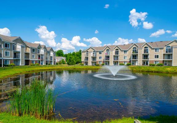 Lake With Fountain at Trillium Pointe Apartment Homes, Michigan, 49201