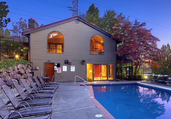 Exterior Image of Community Pool at night at Woodcliffe Apartment Homes in Renton Washington