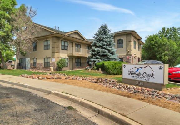 Exterior, landscaping & signage at Hillside Creek Apartments in Prescott, AZ