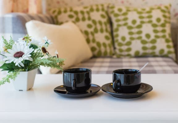 Two Black Coffee Cups