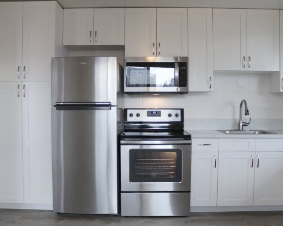 2048 South Beretania Street Apartments kitchen area with appliances and cabinets