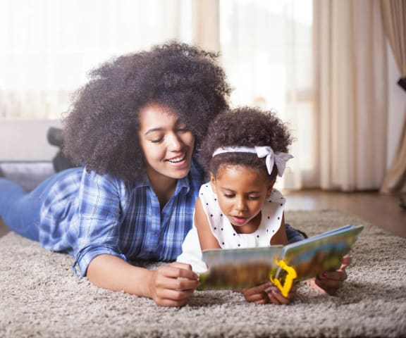stock image- mom in living room reading