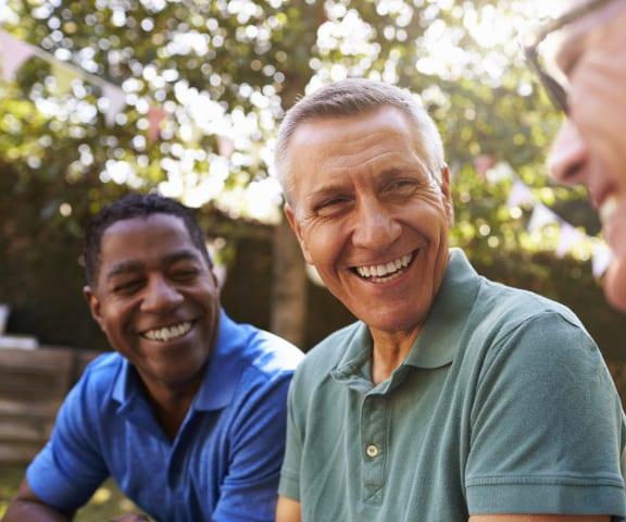 Group of Older Men Sitting and Smiling