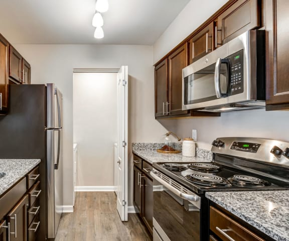 Engineered Wood Flooring In The Kitchen at The Crossings at White Marsh Apartments, Maryland