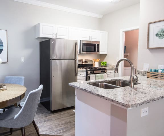 Fully Equipped Kitchens And Dining at Riverstone at Owings Mills Apartments, Owings Mills
