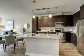 Kitchen Bar With Granite Counter Top at Highgate at the Mile, McLean, 22102