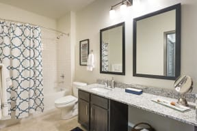 Bathrooms with Granite Countertops and Framed Mirrors at The Gentry at Hurstbourne, Kentucky, 40222