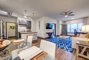 open concept apartment floor plan with ceiling fans