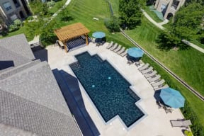 Aerial view of pool with lounge chairs at alvista harmony apartments