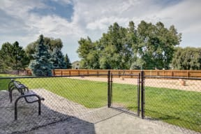 Bark park area with gate at pet friendly apartments in fort collins