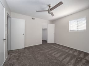 Renovated bedroom with ceiling fans and walk-in closets