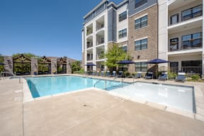 outdoor pool area with building exterior