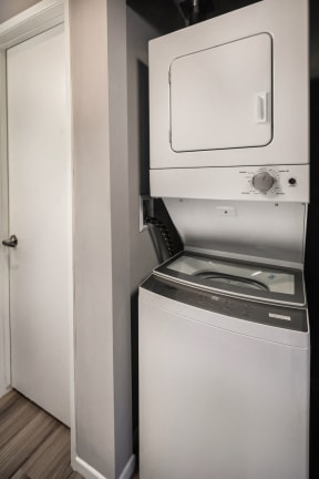 Interior rendering of newly renovated apartment, washer and dryer in unit