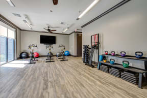 exercise space with cycles and yoga mats