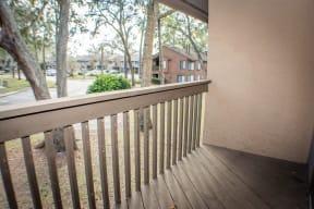 Patio with Railing at Laurel Grove Apartment Homes, Orange Park, Florida