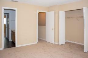 Bedroom with closet and en suite bathroom at Laurel Grove Apartment Homes, Orange Park