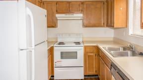 Kitchen with fridge stove at Laurel Grove Apartment Homes, Orange Park, Florida
