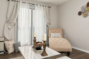 Living Room with Hardwood Style Flooring and Sliding Patio Door with Grey Beige Walls
