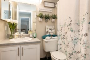 Bathroom with Beige Walls and White Vanity