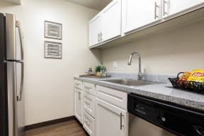 Kitchen with White Cabinets, Stainless Steel appliances and Hardware