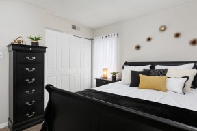 Bedroom with Sliding White Closet Doors