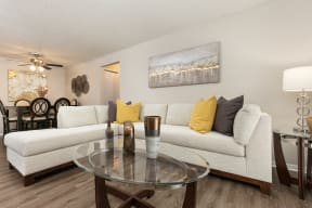 Spacious Living Room with Hardwood Style Flooring and White Trim
