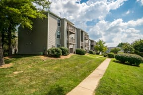 Exterior Of Apartment Homes With Lush Green Grass