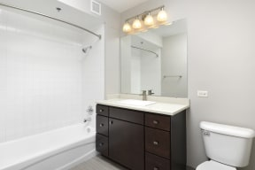 Bathroom with upgraded espresso cabinets