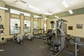 The Grove at Waterford Crossing Apartments Fitness Center with Elliptical, Free Weights, Treadmill, and More