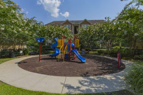The Grove at Waterford Crossing Apartments in Hendersonville - Bedroom with Playground