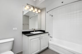 Bathroom with upgraded white cabinets