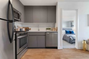 Upgraded kitchen with a sneak peek into the bedroom