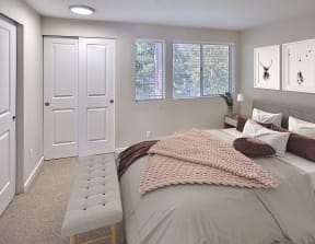 Bedroom that will fit a queen sized bed comfortably. Carpeted with sliding closet doors and 3 medium windows.