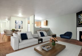 Living Area with large sofa, coffee table and chair. Living area looks into kitchen over a half wall.
